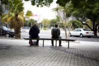 Man and statue sitting on bench [1302104375]