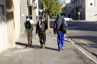Three African men walking on the sidewalk [1303094460]