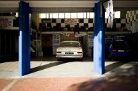 Car parked in mechanic's garage [1303094524]