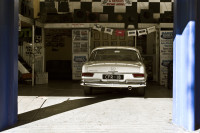 Car parked in mechanic's garage [1303094525]