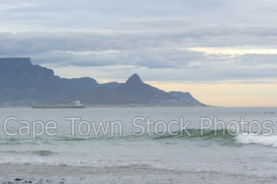 sea,lions head,table mountain,big bay,cloudy,dusk