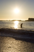 Man in the sea at sunset [1304045042]