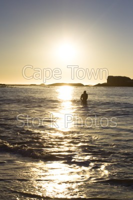 reflection,man,sea,beach,sunset,clifton,silhouette