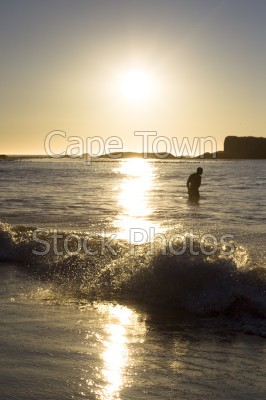 man,sea,beach,sunset,clifton,silhouette