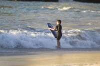 Boy with bodyboard in the surf [1304055123]
