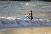 Boy with bodyboard in the surf [1304055124]