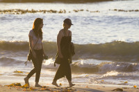 Two girl friends walking on the beach [1304055143]