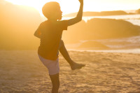 Silhouette of a boy at sunset on Clifton beach [1304055154]