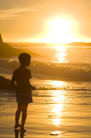 Silhouette of a boy at sunset on Clifton beach [1304055174]
