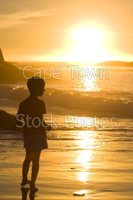 sea,boy,beach,sunset,clifton,silhouette,waves