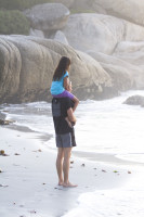 Father carrying daughter on shoulders at beach [1304055244]