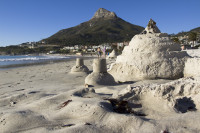 Sand castles at Camps Bay beach [1304125288]