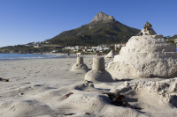 Sand castles at Camps Bay beach [1304125289]