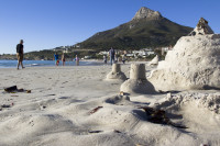 Sand castles at Camps Bay beach [1304125290]