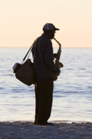 Saxophonist silhouette on the beach [1304125384]