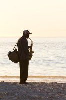 Saxophonist silhouette on the beach [1304125386]