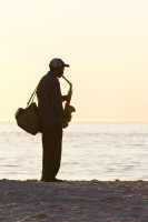 Saxophonist silhouette on the beach [1304125388]