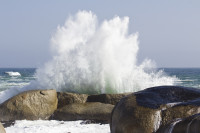 Waves crashing against Camps Bay boulders [1308047053]