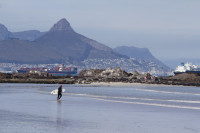 Lion's Head with surfers walking on the beach [1309227230]