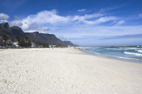Long white sands of Camps Bay beach [1309247327]