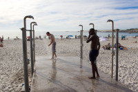 Showering on the beach at Camps Bay [1310277895]