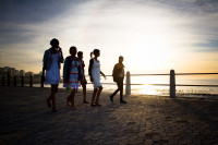 Friends walking the Sea Point promenade at sunset [1311018312]