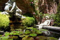 Pond with lilies and statues [1311108469]