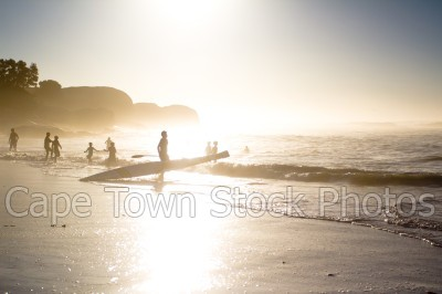 people,sunset,clifton,silhouette,water sport,surfski