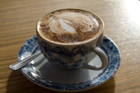 Coffee in old decorative cup [1403080510]