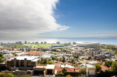 sea,blue sky,green point,cloudy,cape town stadium