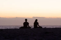 Couple silhouetted on Camps Bay beach [1503098607]