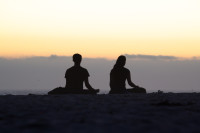Couple silhouetted on Camps Bay beach [1503098609]