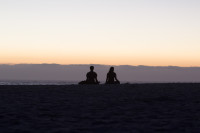 Couple silhouetted on Camps Bay beach [1503098612]