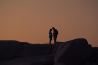 Couple silhouetted on Camps Bay beach [1503098615]