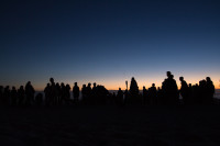 People silhouetted on Camps Bay beach [1503098652]
